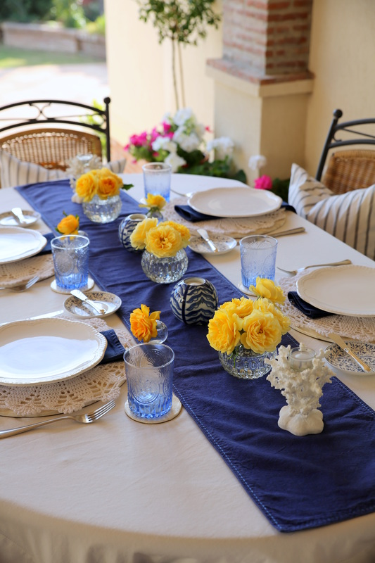 Blue, white and yellow tablescape by The Belle Blog