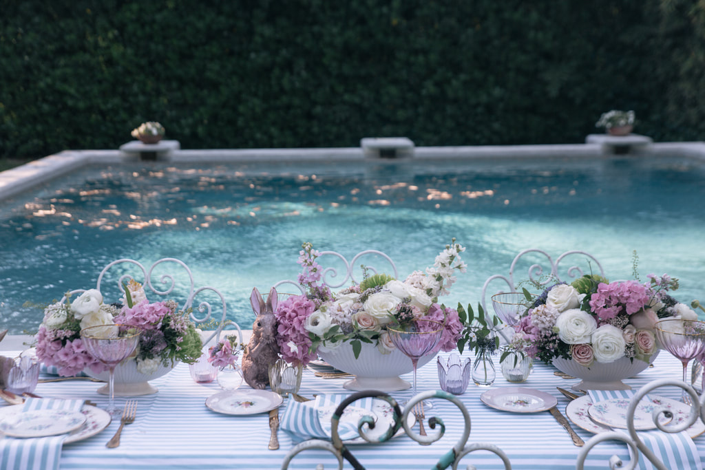 Easter stripes by the pool by The Belle Blog. A beautiful Easter tablescape